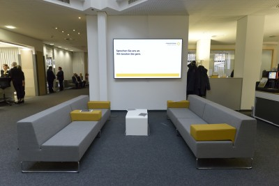 The waiting area with tablets and info screen in the new Flagship branch Bochum